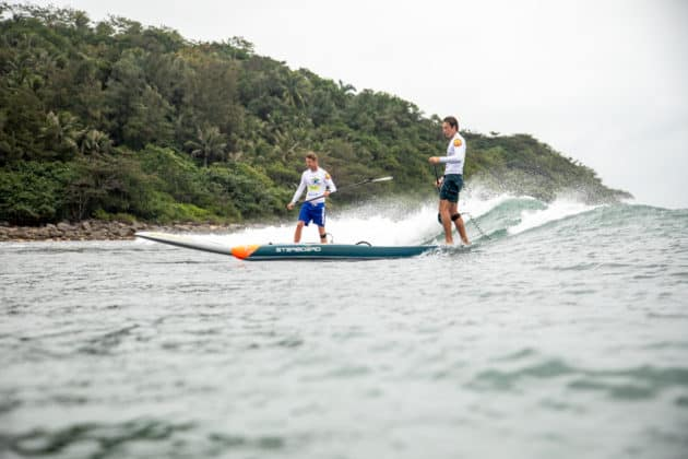 Thomas King from South Africa and Harry Maskell from Australia racing back on a wave
